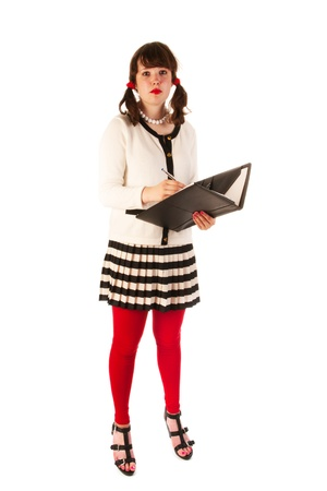 pencil skirt: Young woman at the office writing in leather file Stock Photo