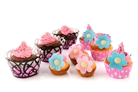 Many colorful cupcakes with pink butter cream
