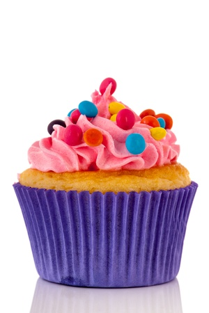 birthday cupcakes: Cupcake for child party with colorful candy Stock Photo