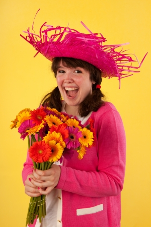 Young woman is having lots of fun with bouquet colorful Gerber flowers Stock Photo - 14939770