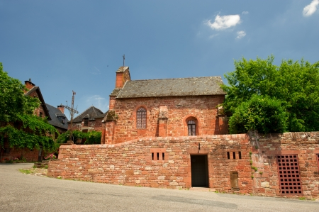 Typical red church in French Collonges la Rouge Stock Photo - 15141392