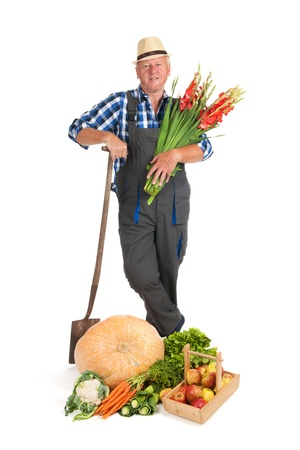 Gardener proud on vegetables fruit and flowers photo