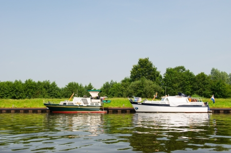 eem: Motorboats laying in Dutch river