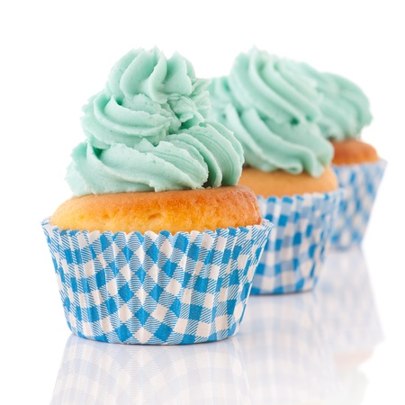 colorful cupcakes in blue with green butter cream photo