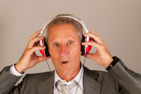Senior man is listening to music photo