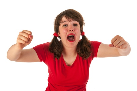 tailes: Portrait of an angry young teen girl in red Stock Photo