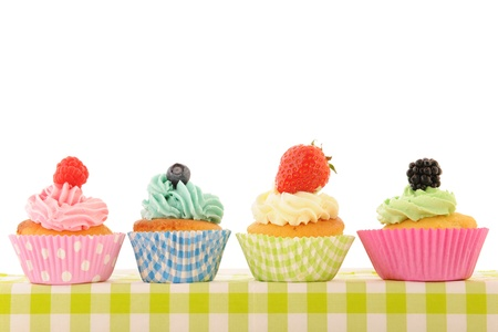 assortment fruit cupcakes isolated over white background photo