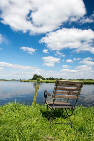 eem: Landscape with Dutch river the Eem and empty chair Stock Photo