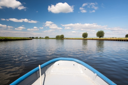 Landscape with Dutch river the Eem and rowboat