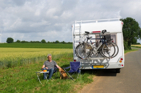 Man with camper in agriculture landscape photo