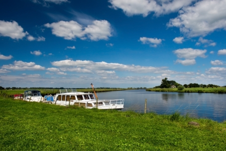 eem: Landscape with Dutch river the Eem and motor boats Stock Photo