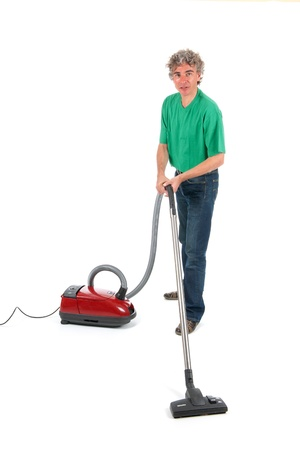 houseman: man working in house with vacuum cleaner