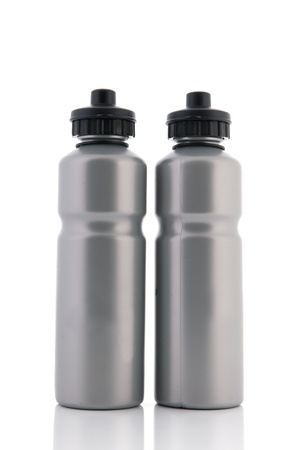 grey water: Two grey sports water bottles isolated over white bottles