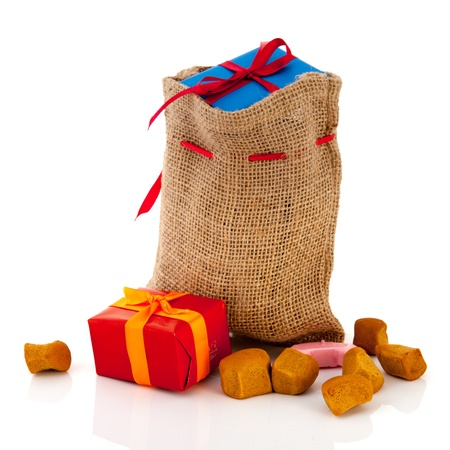 Bag Dutch Sinterklaas presents and pepernoten Stock Photo - 15910469