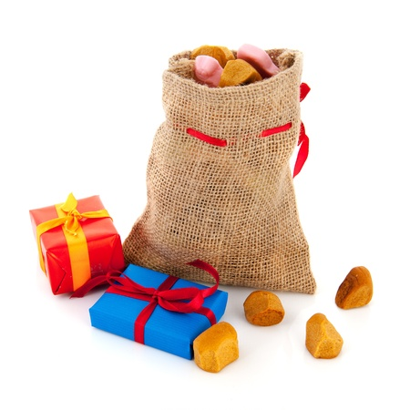 Bag Dutch Sinterklaas presents and pepernoten Stock Photo - 15910491