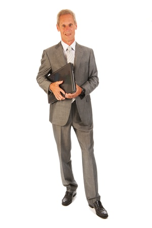 Senior business man with laptop isolated over white background Stock Photo - 15935134