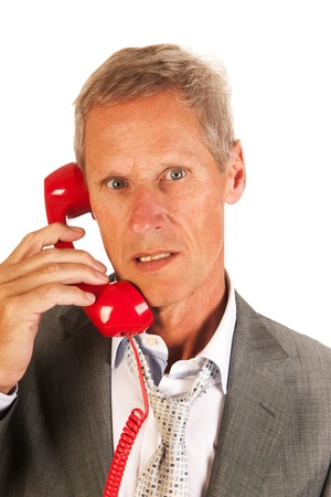 Senoir business man is on the phone isolated over white background photo