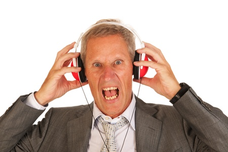 Senior man is mad listening to music photo
