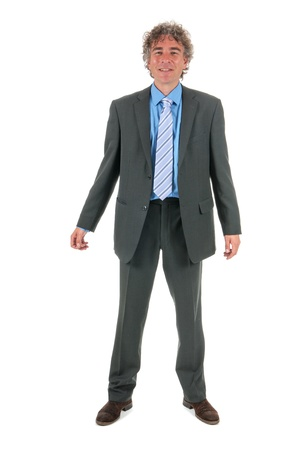 full strenght: Handsome adult man with curly hair and formal suit Stock Photo