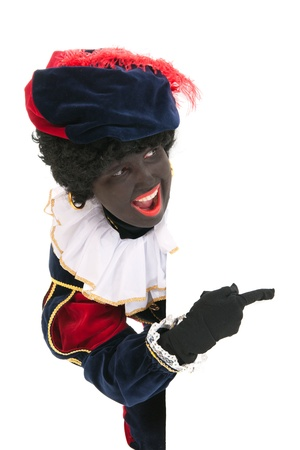 Dutch character as black pete for typical Sinterklaas holidays in portrait behind white board Stock Photo - 15998939