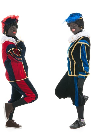 petes: Dutch characters as black petes for typical Sinterklaas holidays standing and leaning Stock Photo
