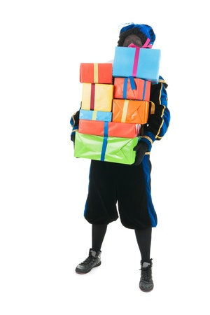 Dutch character as black pete for typical Sinterklaas holidays is carrying a lot of presents Stock Photo - 15988768