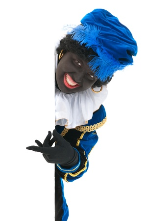 Dutch character as black pete for typical Sinterklaas holidays in portrait behind white board Stock Photo - 15988805