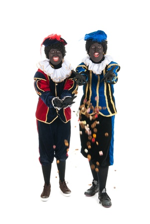 Dutch characters as black petes for typical Sinterklaas holidays throwing candy photo