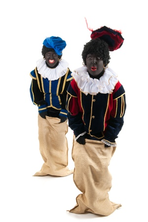 black pete: Dutch characters as black petes for typical Sinterklaas holidayshaving fun with jute bags