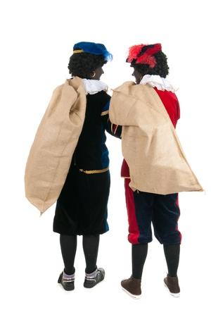 Dutch characters as black petes for typical Sinterklaas holidays with jute bags full of presents photo