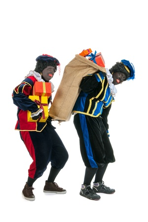 Dutch characters as black petes for typical Sinterklaas holidayswith jute bags Stock Photo - 15998951