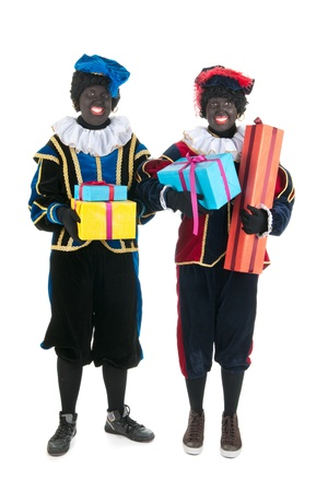 Dutch characters as black petes for typical Sinterklaas holidays with presents isolated over white background Stock Photo - 15988872