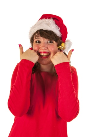 Winter girl with red sweater and hat of Santa Claus is doiing thumbs up photo