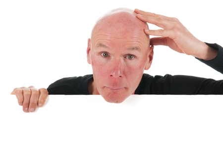 head shots: Portrait bald man with white board isolated in studio
