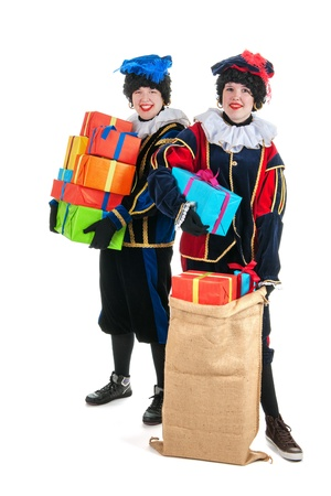 Dutch characters as white petes for typical Sinterklaas holidays with jute bags Stock Photo - 15894375
