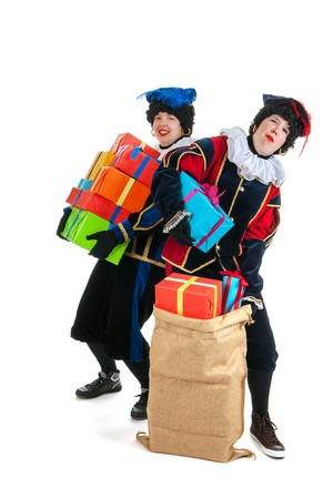 Dutch characters as white petes for typical Sinterklaas holidays with jute bags photo