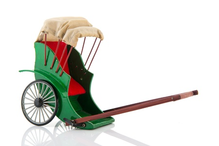 a two wheeled vehicle: Green empty Pulled rickshaw isolated over white background