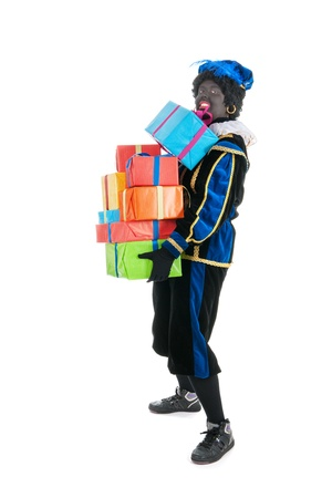 Dutch character as black pete for typical Sinterklaas holidays with many presents Stock Photo - 16096755