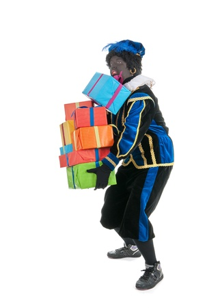 Dutch character as black pete for typical Sinterklaas holidays carrying many presents photo
