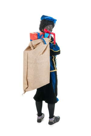 Dutch character as black pete for typical Sinterklaas holidays with many presents Stock Photo - 16096799