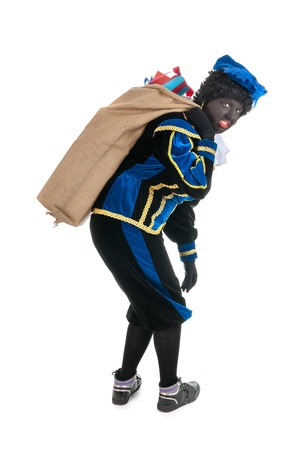 Dutch character as black pete for typical Sinterklaas holidays with many presents in jute bag Stock Photo - 16096838