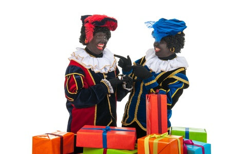 petes: Dutch characters as black petes for typical Sinterklaas holidays with lots of fun Stock Photo
