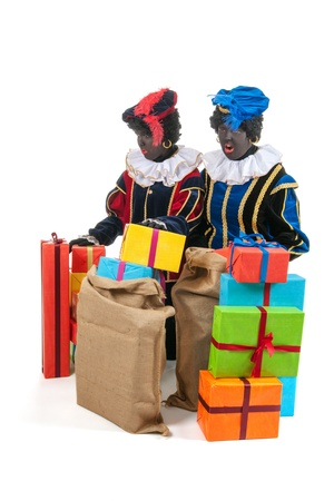Dutch characters as black petes for typical Sinterklaas holidays with jute bags photo