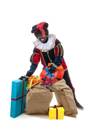 Dutch character as black pete for typical Sinterklaas holidays with many presents Stock Photo - 16096896