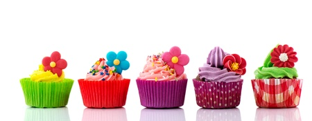 marzipan: Row colorful cupcakes with buttercream flowers and confetti