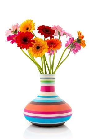 vase: Colorful bouquet Gerber flowers in modern striped vase
