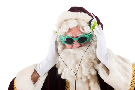 Portrait of Santa Claus listening to cool music photo