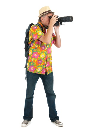 telezoom: Typical tourist with backpack and photo camera Stock Photo