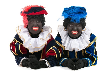 Dutch  black petes for typical Sinterklaas holidays laying at the floor Stock Photo - 16303518