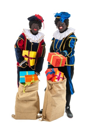 Dutch characters as black petes for typical Sinterklaas holidayswith jute bags Stock Photo - 16303520